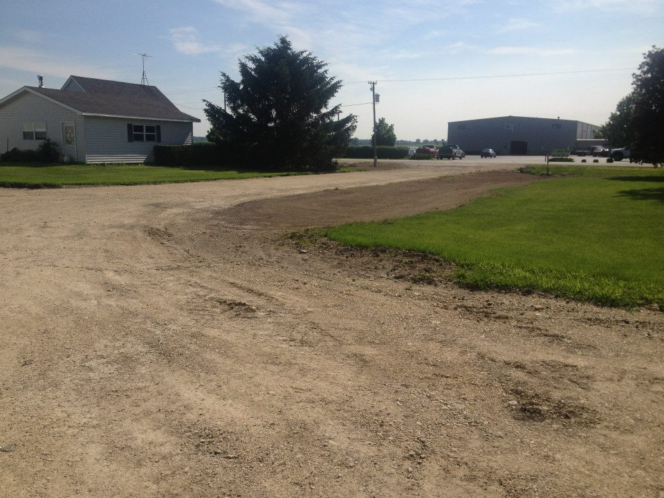 Gravel Road 3 - Putting down gravel for a farm house driveway.